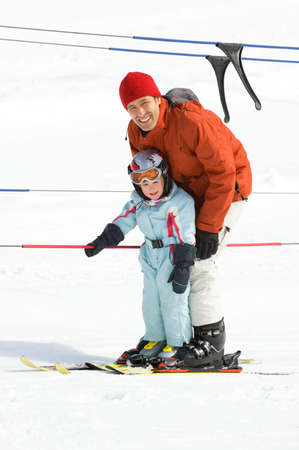 Father with his daughter in the ski lift photo