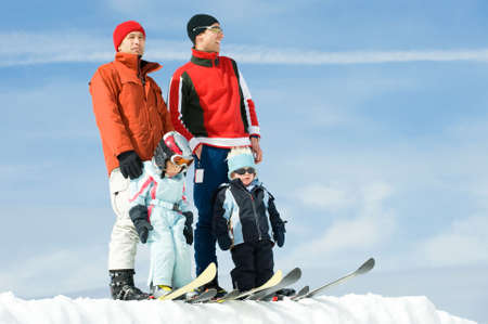 Young people with ski in front of blue sky photo