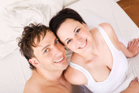 Young couple  have some fun in the bed photo