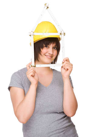 workwoman: Full isolated studio picture from a young woman with a folding rule Stock Photo