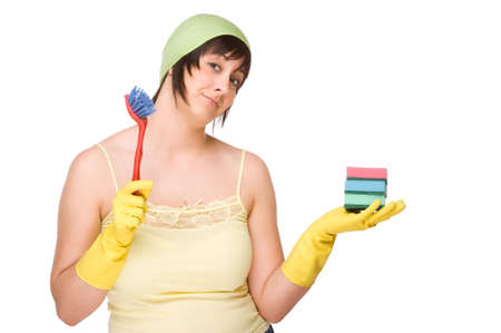 Full isolated portrait of a beautiful caucasian woman with some cleaning equipment photo