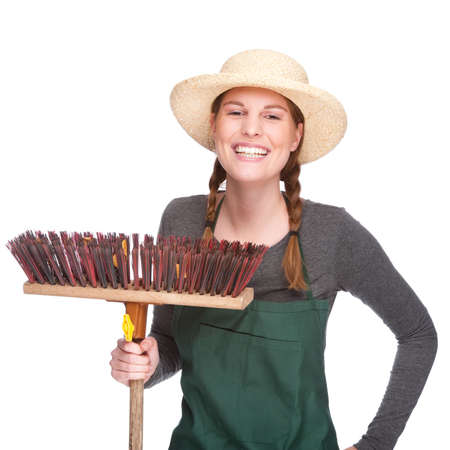 Full isolated portrait of a beautiful caucasian gardener with besom photo