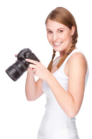 Full isolated studio picture from a young and beautiful woman with camera photo