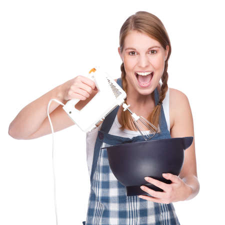 Full isolated studio picture from a young and beautiful housewife with kitchen machine