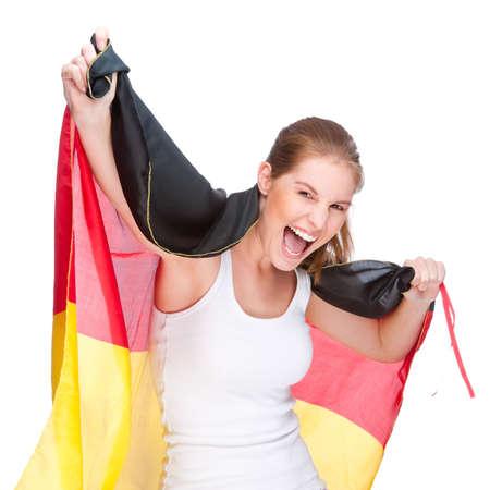 bandera alemania: Foto de estudio aislado de una mujer joven y bella con la bandera de Alemania (ventilador del deporte)