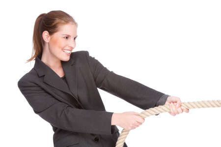 Full isolated studio picture from a young and beautiful business woman doing tug of war Stock Photo - 6269972