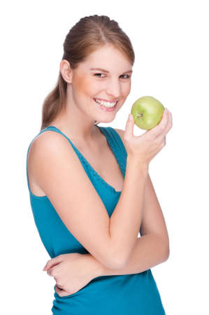 gleeful: Full isolated studio picture from a young woman with an apple