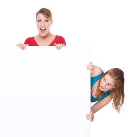 Full isolated studio picture from two young woman with white copyspace sign (banner) photo