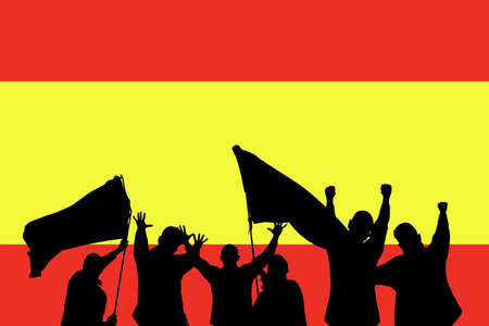 Silhouette from some sport fans in front of the flag from spain photo