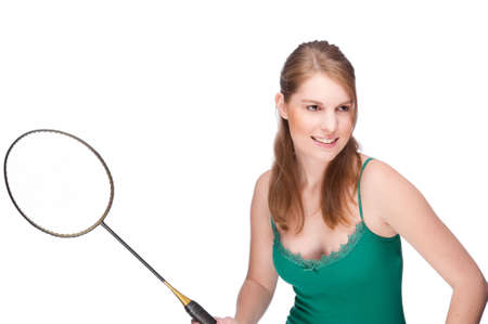 Full isolated studio picture from a young woman with badminton racket photo