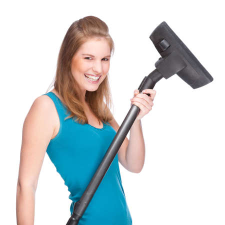Full isolated studio picture from a young and beautiful woman with vacuum cleaner Stock Photo - 6459586