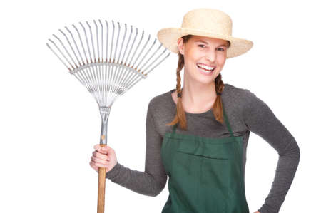 Full isolated studio picture from a young and beautiful gardener with leaf rake photo
