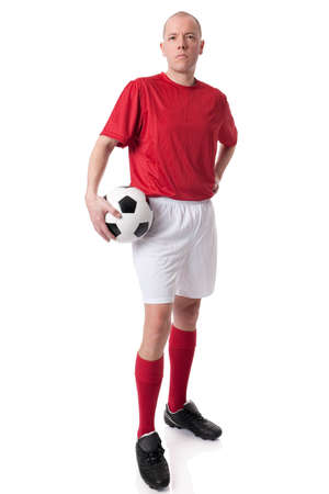 tricot: Full isolated studio picture from a young soccer player with ball Stock Photo
