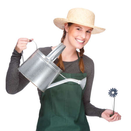 Full isolated portrait of a beautiful caucasian gardener with watering can Stock Photo