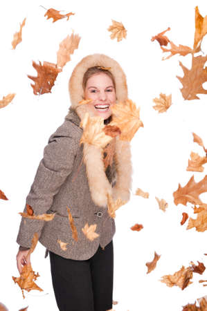 Full isolated studio picture from a young and beautiful woman with winter clothes and falling foliage photo