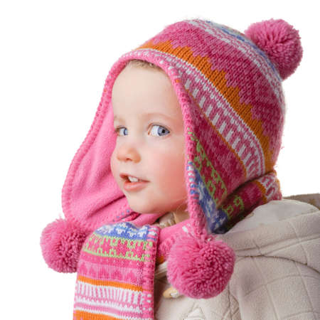 wolly: Full isolated studio picture from a young girl with winter clothes
