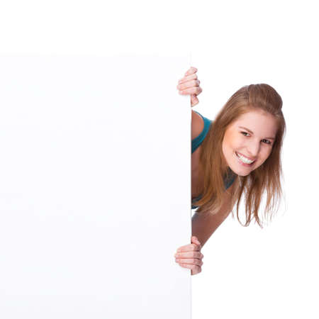 peep: Full isolated studio picture from a young woman with white copyspace sign (banner) Stock Photo