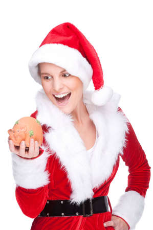 Full isolated studio picture from a beautiful woman in christmas dress with a piggybank photo