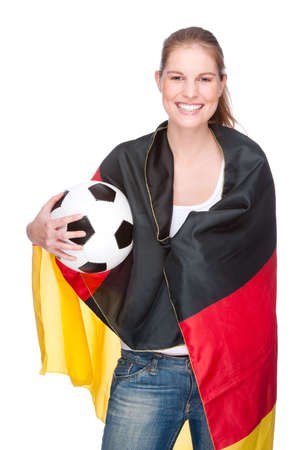 Full isolated studio picture from a young and beautiful woman with football and Germany flag photo