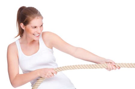Full isolated studio picture from a young and beautiful woman doing tug of war photo