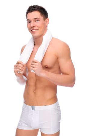 homme nu: Plein d'image studio isol? d'un jeune homme nu avec des sous-v?tements Banque d'images