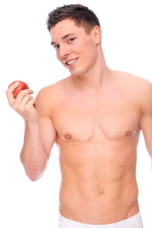hombre desnudo: Aislado de completo imagen de estudio de un hombre joven desnudo con ropa interior una manzana