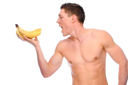 Full isolated studio picture from a young naked man with banana Stock Photo - 7479627