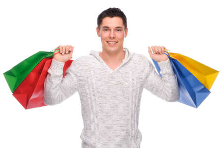 spending: Full isolated studio picture from a young man with shopping bags