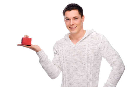 Full isolated studio picture from a young man with small present photo
