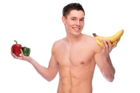 Full isolated studio picture from a young naked man withpepper and banana photo