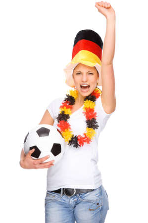jubilate: Full isolated studio picture from a young and beautiful woman with football and Germany flag