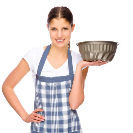 woman baking: Full isolated studio picture from a young housewife in the kitchen