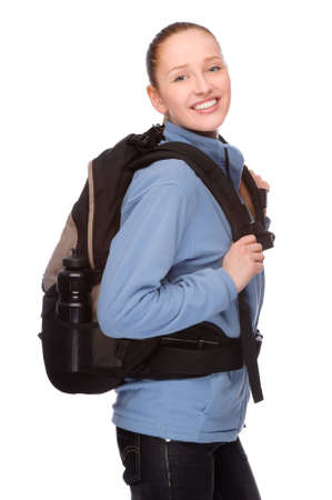Full isolated studio picture from a young and happy backpacker Stock Photo - 7650516