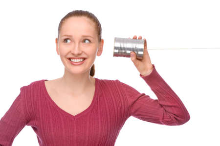 Full isolated studio picture from a young and happy woman with tin phone Stock Photo - 7650276
