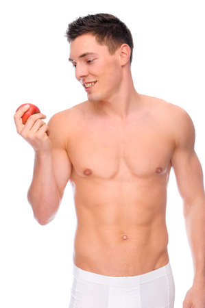 Full isolated studio picture from a young naked man with underwear an apple Stock Photo - 8095720