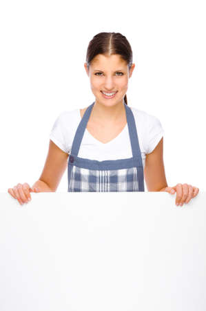 Full isolated studio picture from a young housewife in the kitchen photo