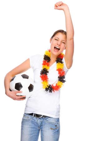 Volledig geïsoleerde studio foto van een jonge en mooie vrouw met voet bal en Duitsland vlag Stockfoto