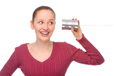 Full isolated studio picture from a young and happy woman with tin phone Stock Photo - 8095728