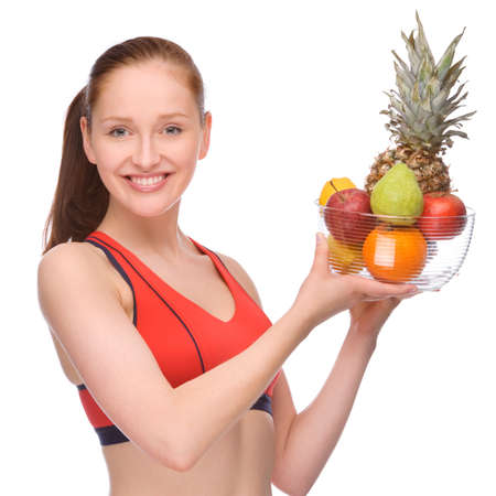 Full isolated studio picture from a young woman with some fruits photo