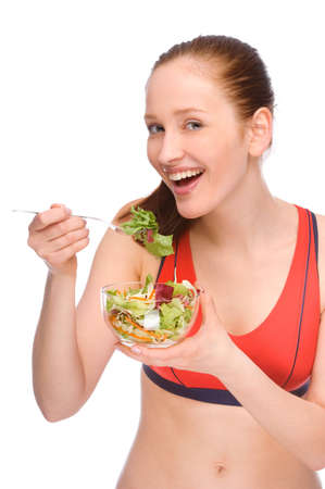 Full isolated studio picture from a young woman with salad photo
