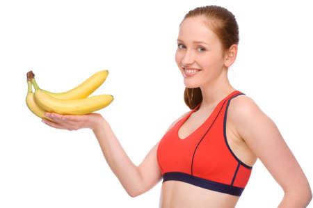 Full isolated studio picture from a young woman with banana photo