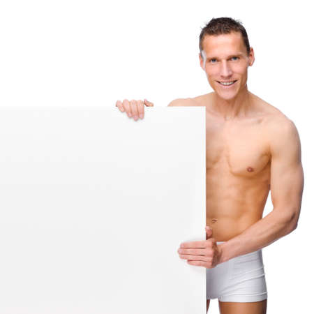 Full isolated studio picture from a young naked man with white sign photo