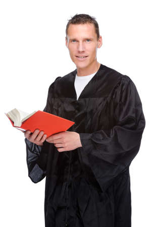statute: Full isolated studio picture from a young judge (lawyer) with statute book Stock Photo