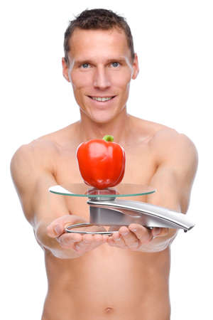Full isolated studio picture from a young naked man with scales and pepper photo