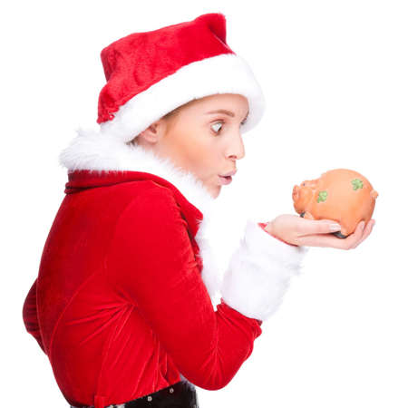 Full isolated studio picture from a beautiful woman in christmas dress with a piggybank Stock Photo - 8442351