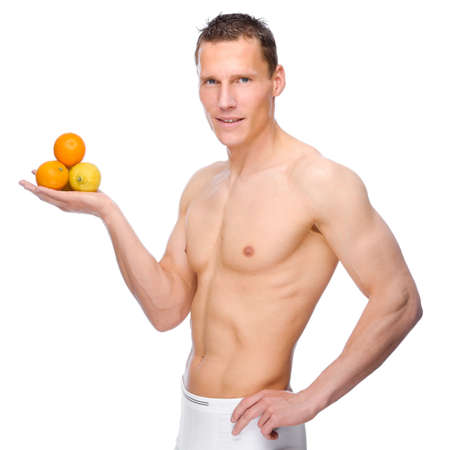 Full isolated studio picture from a young naked man with some fruit photo