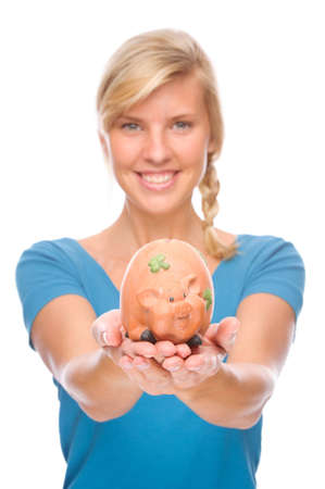 Full isolated portrait of a beautiful woman with piggybank photo