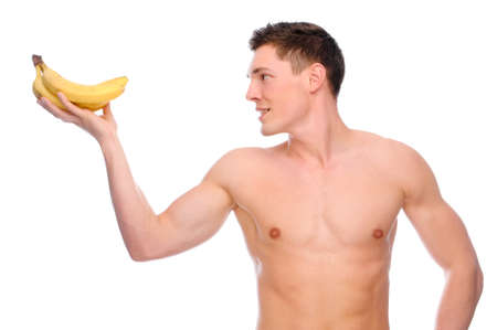Full isolated studio picture from a young naked man with banana photo