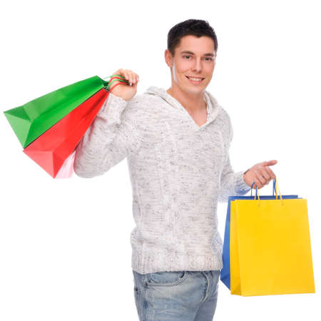 shopping man: Full isolated studio picture from a young man with shopping bags