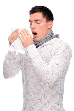 estornudo: Foto estudio aislado de un hombre joven con pa�uelo
